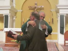 Stan Driscoll is welcomed to the Secular Franciscan Order by Father Douglas Reed. Stan made his profession on Nov. 16, 2013, at St. Michael the Archangel Catholic Church, Cary.